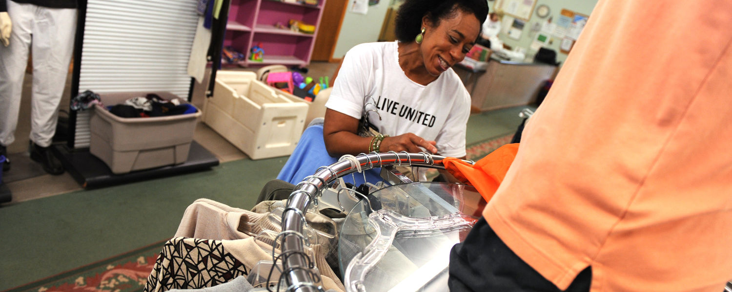 A Kent State employee sorts donated clothing at a free clothing store in Ravenna.