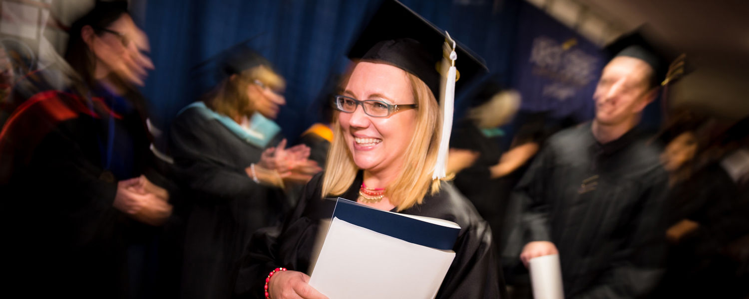 Student overcomes horrible conditions to graduate with master's degree