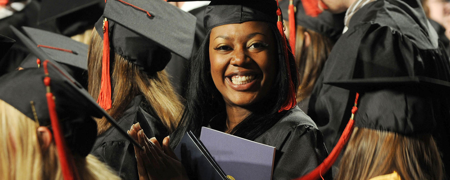 A Kent State student smiles after receiving her diploma during a Commencement ceremony held in the Memorial Athletic and Convocation Center.