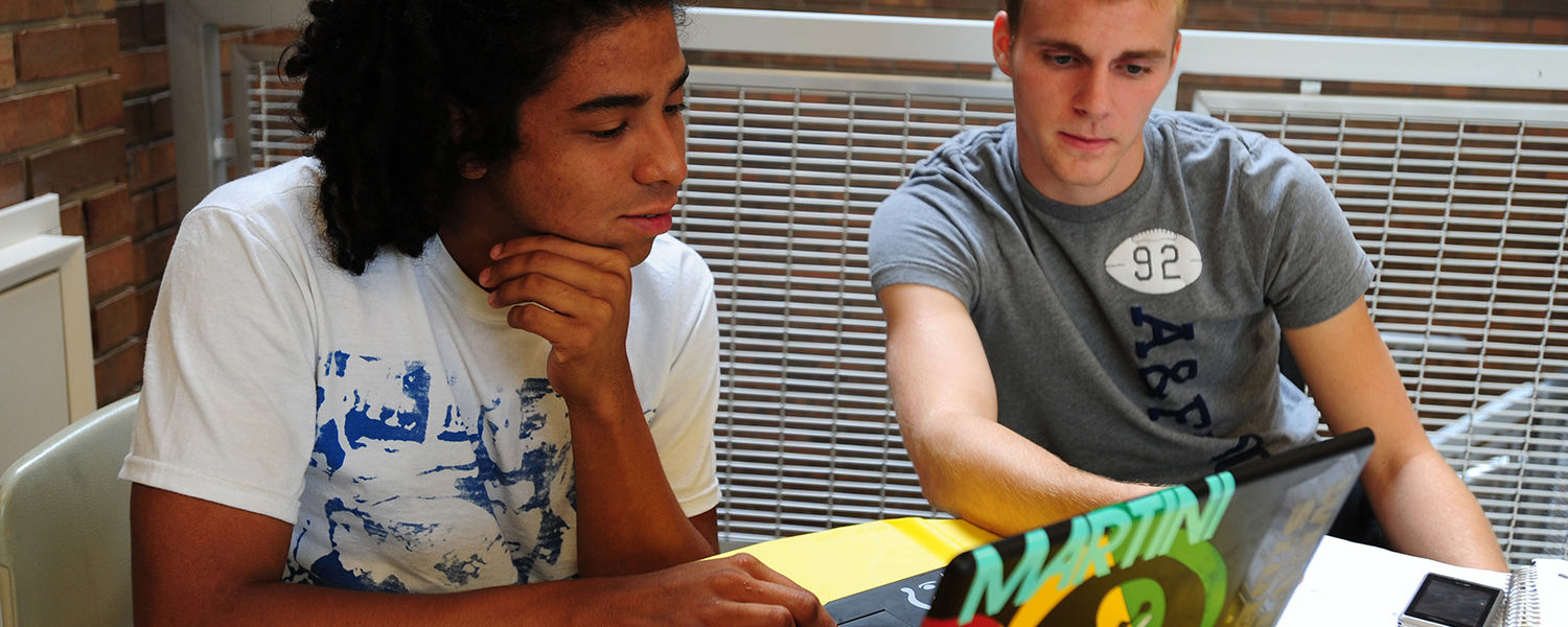 Two Kent State students study before class in the Business Administration Building.