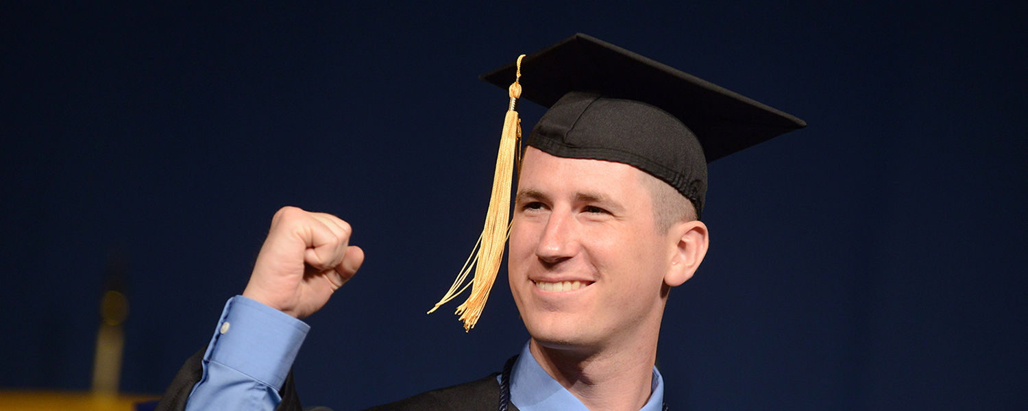 A Kent State student celebrates receiving his degree during a recent Commencement ceremony.