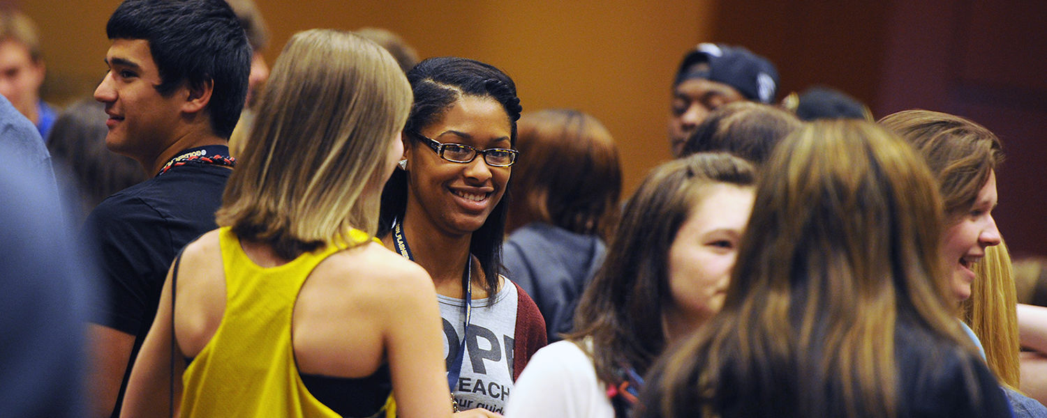 New Kent State students meet and greet one another following a Destination Kent State presentation in the Kent Student Center Ballroom.