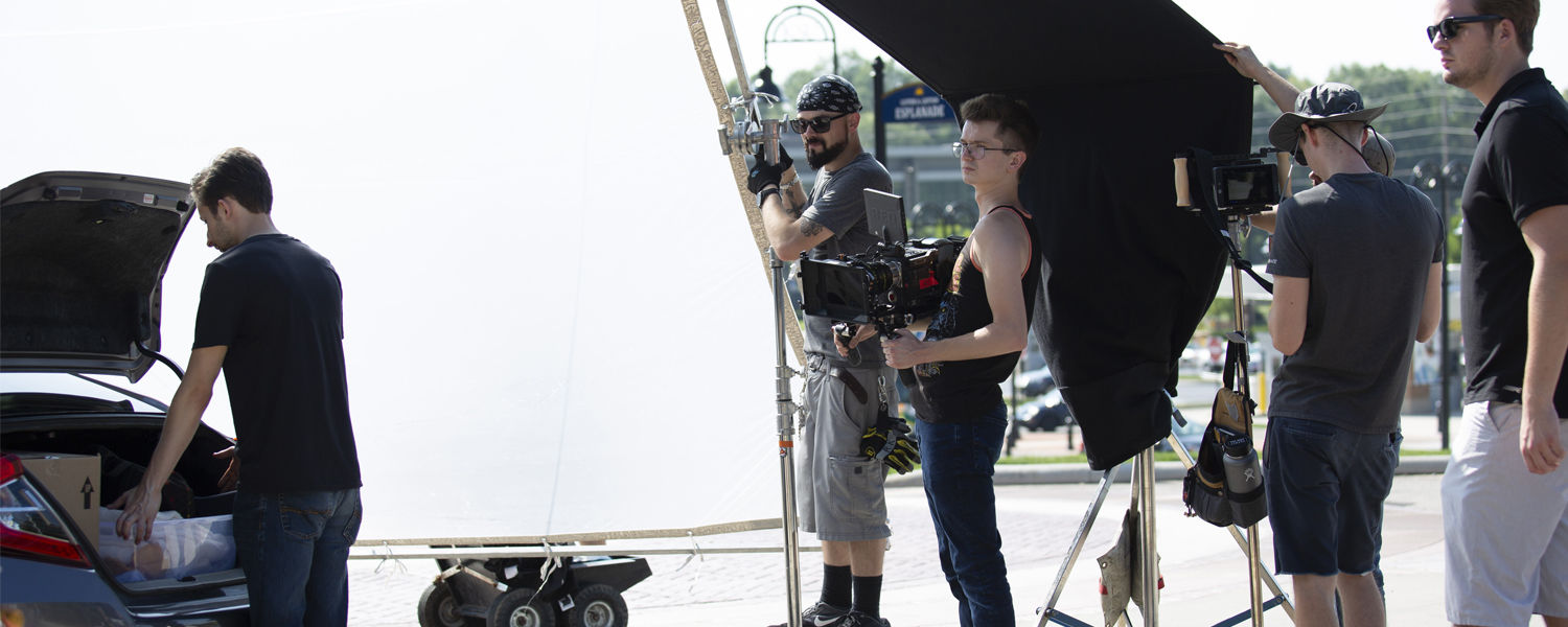 Kent State graduates, students and crew film a scene from Kent State's spring campaign commercial.