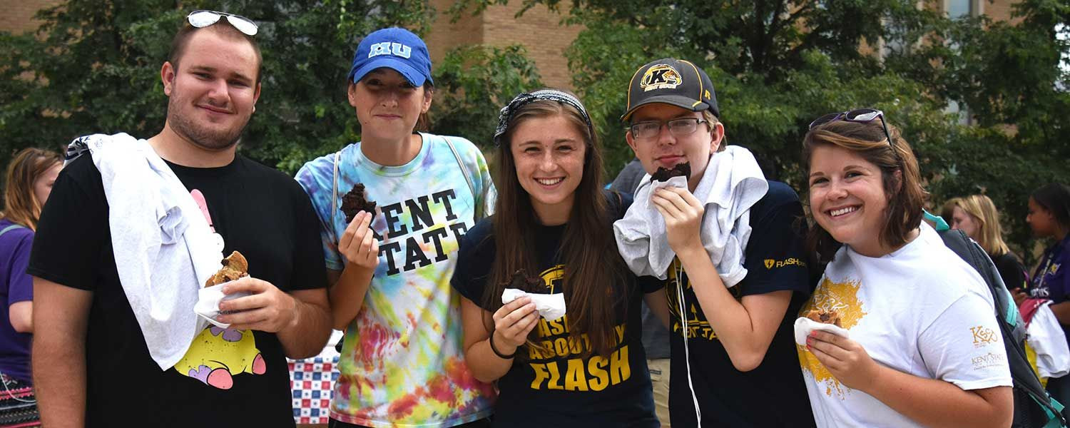 Kent State students enjoy free cookies at the 2016 Black Squirrel Festival.