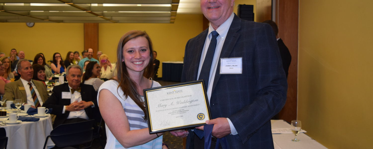 Mary Waddington, a Chemistry major (L) and James Blank, Ph.D., dean of the College of Arts and Sciences (R)
