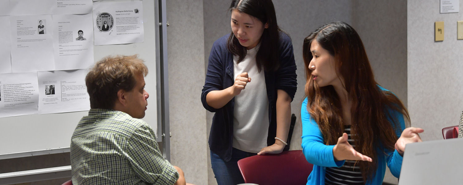 Michael Carl (left), Emma (center) and Yanmei Liu (right) brainstom ideas on translation memories at the Second MEMENTO Boot Camp held in Satterfield Hall on the Kent campus