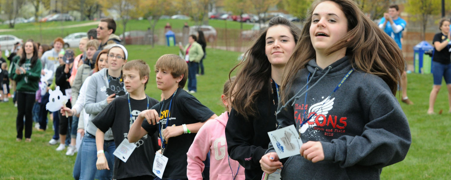 Kids participating in Lil' Sibs Weekend dance on Manchester Field.