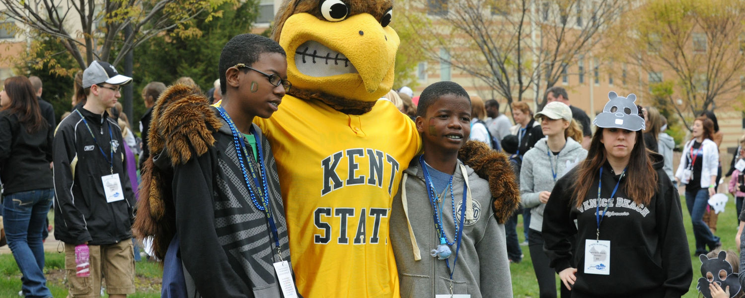 Younger siblings of Kent State students pose with Flash during a Lil' Sibs Weekend event near Centennial Court.