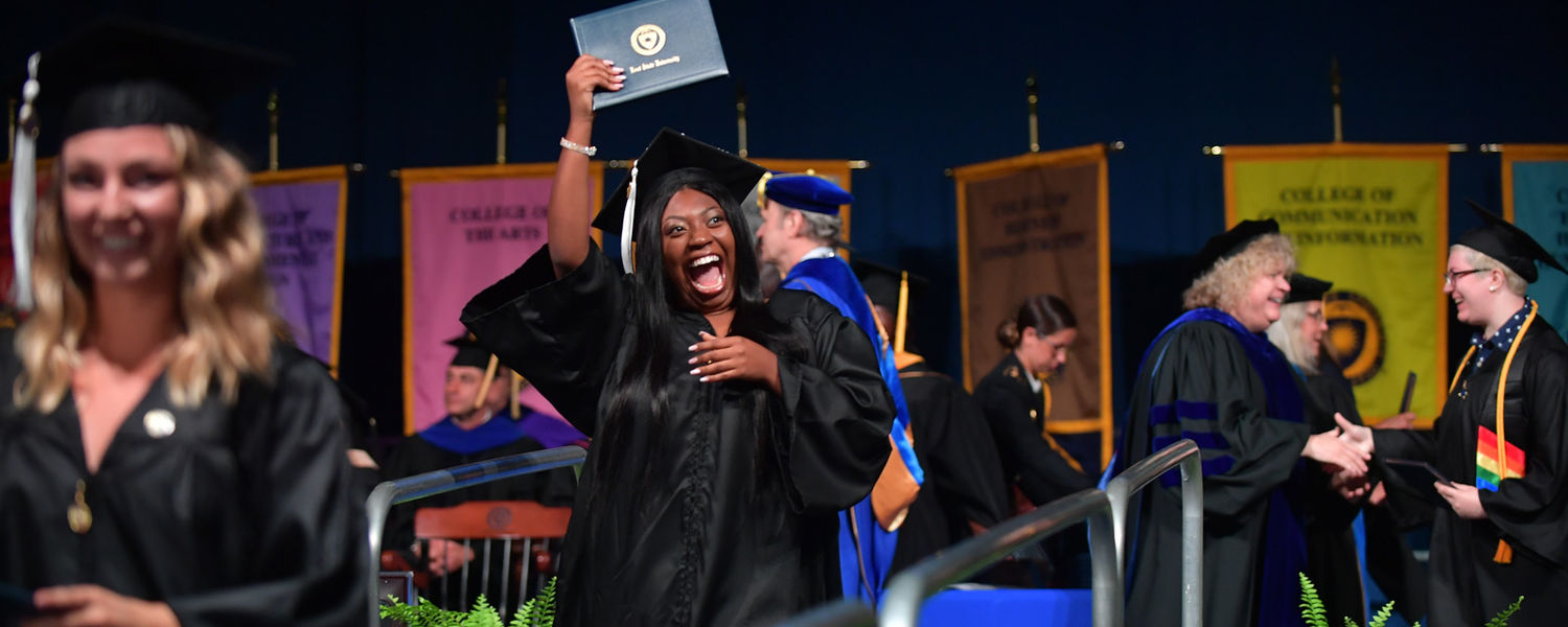 The smile tells the story. An undergraduate student can't contain her joy moments after receiving her degree during the Aug. 17 undergraduate commencement ceremony at the Memorial Athletic and Convocation (MAC) Center.