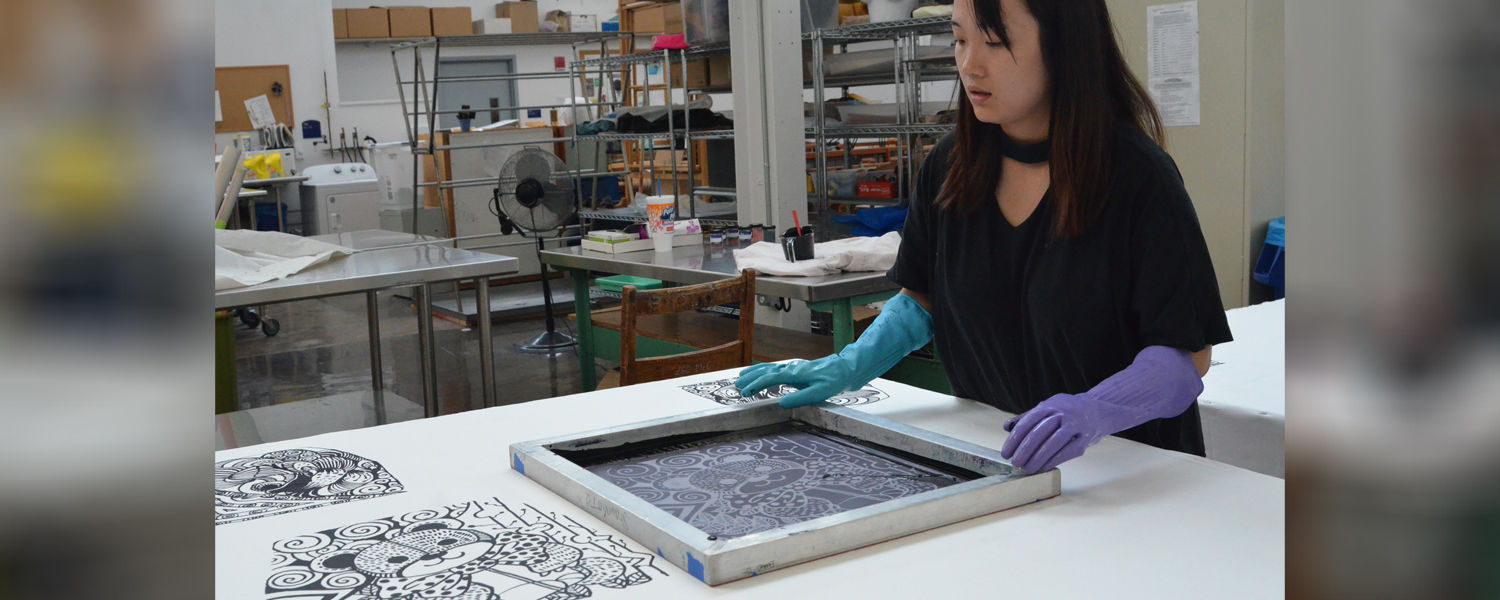 "Supima Design Competion finalist Shuxian Kong works on her collection ""Doodling Childhood."""