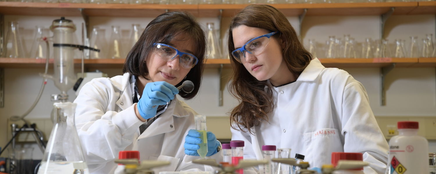 LCI Professor Elda Hegmann works in the lab with a student