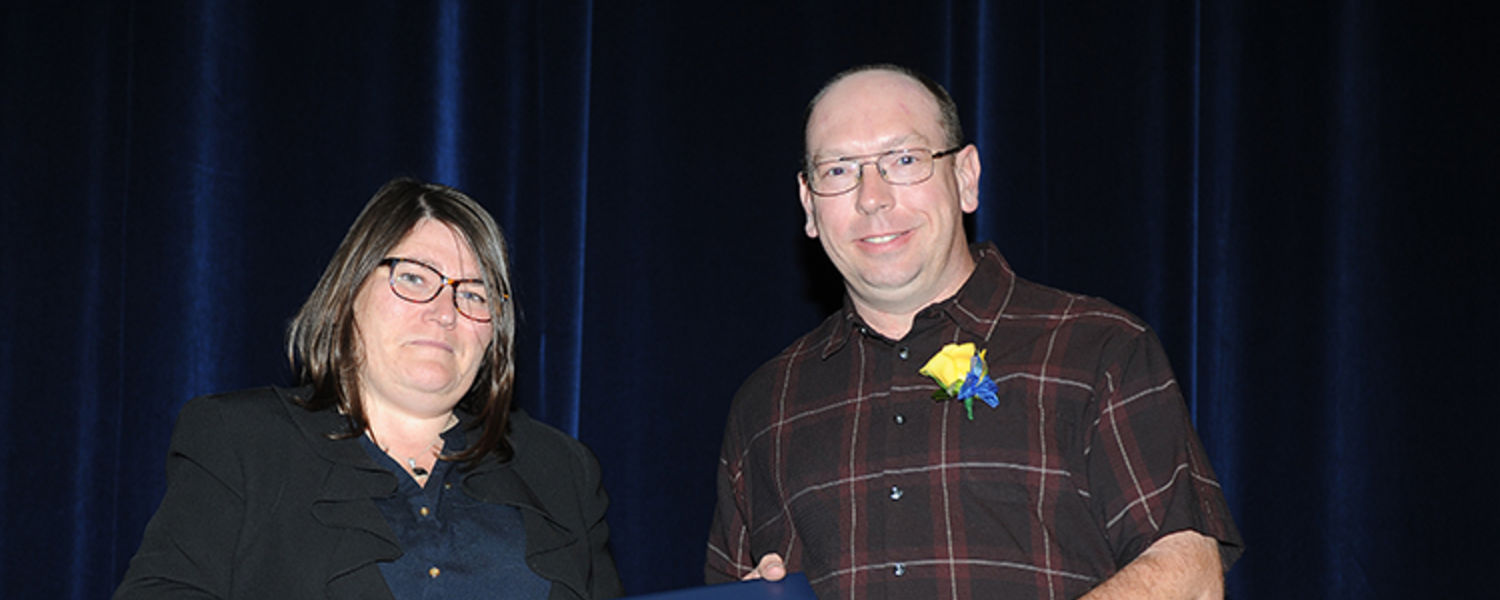 Brian Hall with Dr. Mandy Munro-Stasiuk