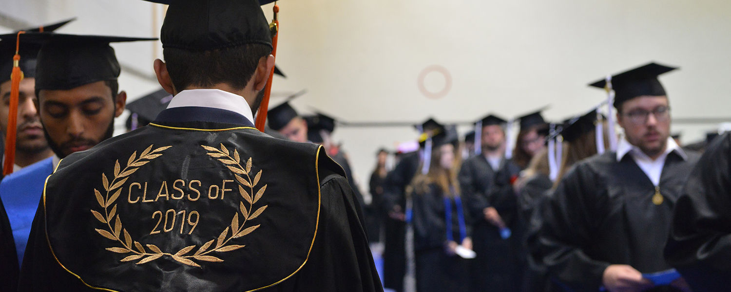 Getting ready.  A member of the Class of 2019 prepares to line up for the beginning of the undergraduate commencement ceremony Aug. 17 at the Memorial Athletic and Convocation (MAC) Center. He joined more than 1,000 fellow students who were recognized.