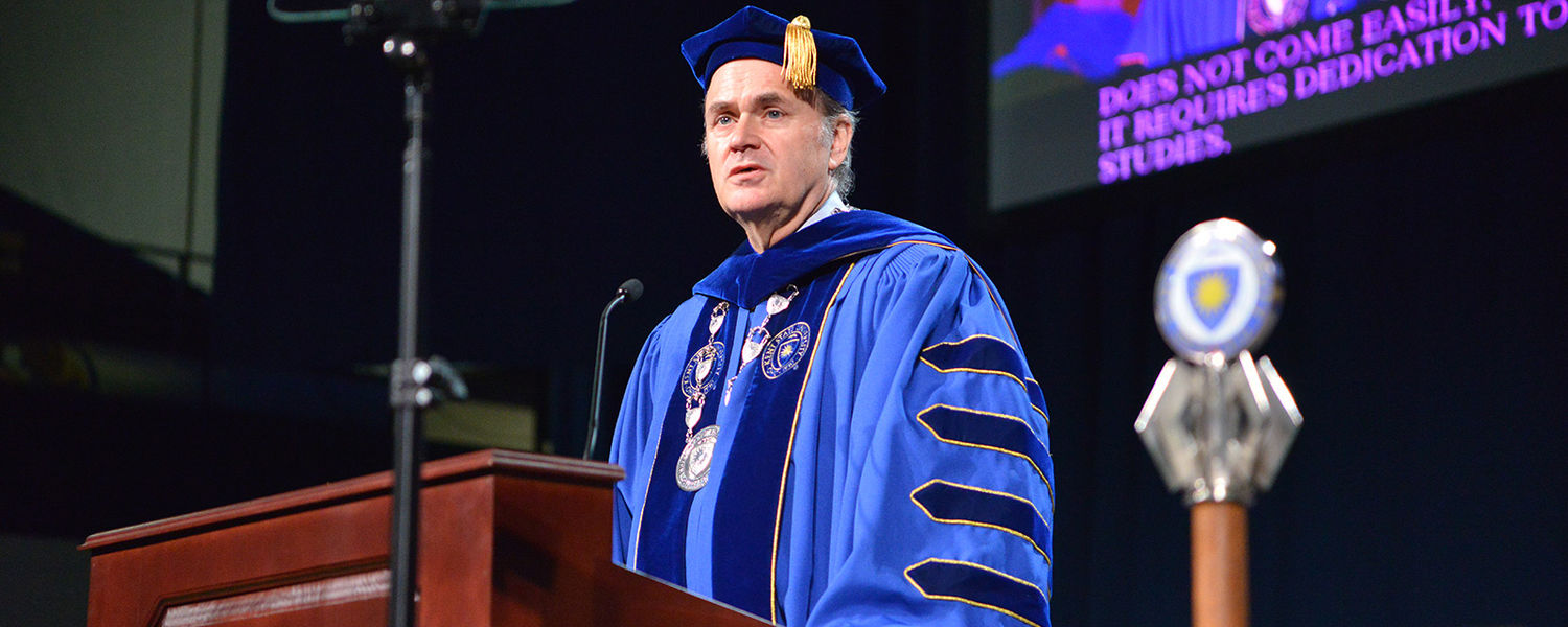 Presidential Pride.  Kent State President Todd Diacon addresses more than 1,000 graduates and their families during the undergraduate commencement ceremony Aug. 17 at the Memorial Athletic and Convocation (MAC) Center.