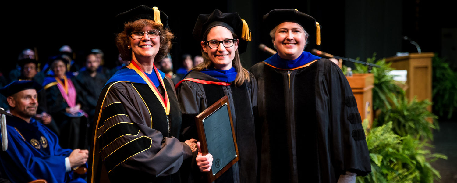 Pictured with Dean Denise Seachrist (left) and Faculty Chair Deirdre Warren (right), Dr. Lindsay Starkey is the recipient of the 2017 Distinguished Teaching Award.