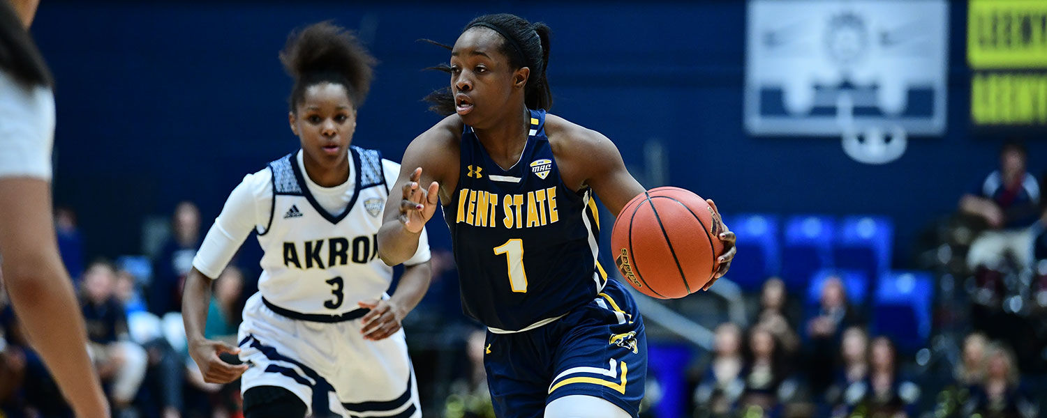 Kent State guard Naddiyah Cross dribbles past Akron defenders during a Feb. 24 home game. The Golden Flashes beat Toledo in overtime to advance in the 2018 MAC Women's Basketball Tournament.