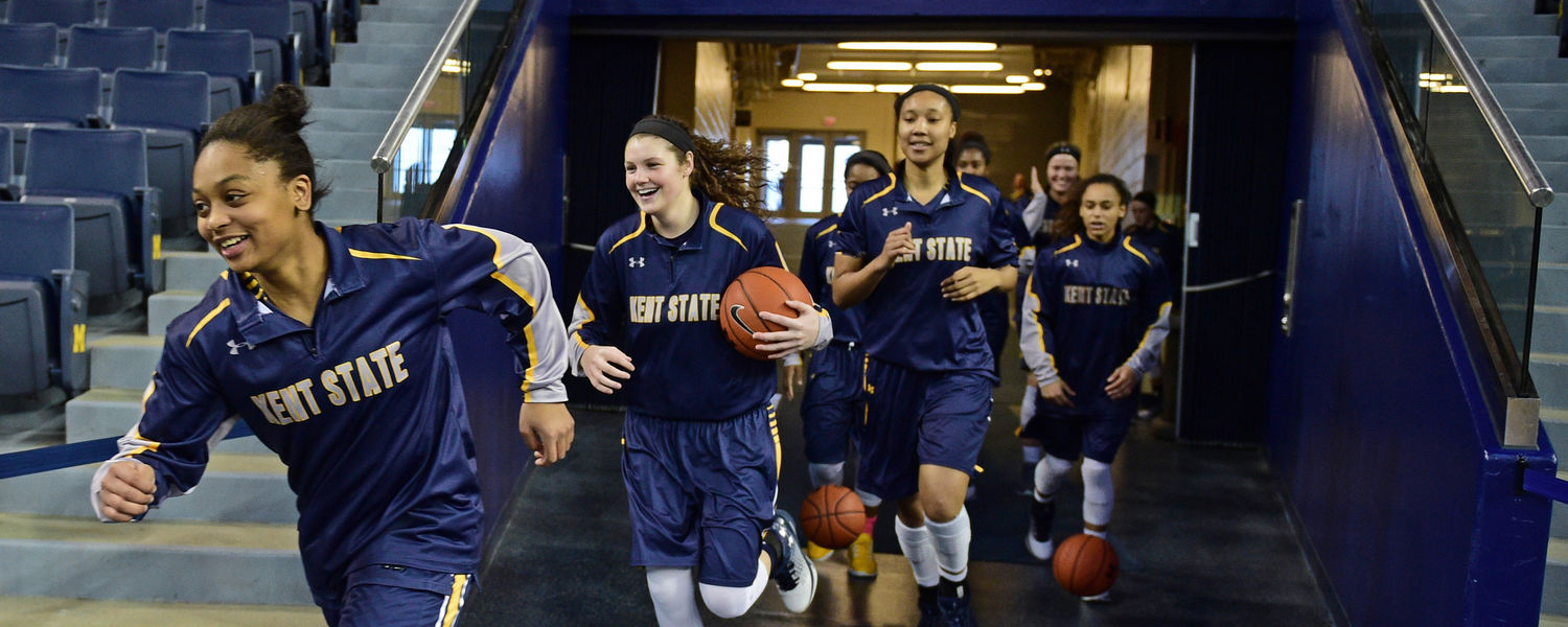 The Kent State Golden Flashes make their way onto the court for a WNIT first-round game against the Michigan Wolverines.