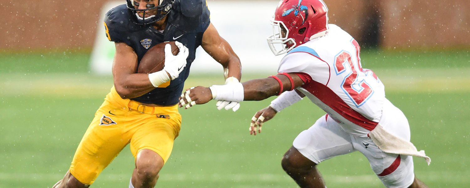 Kent State wide receiver Kris White turns upfield after a reception and eluding a Delaware State tackler.