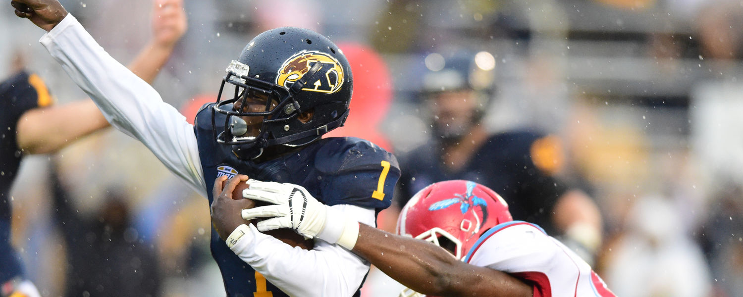 Kent State wide receiver Antwan Dixon celebrates while sprinting into the end zone to score a touchdown for the Golden Flashes.