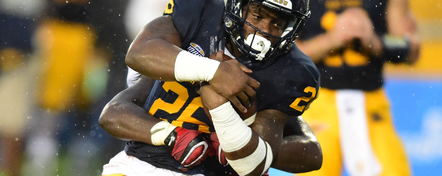 Kent State running back Myles Washington attempts to break a tackle.