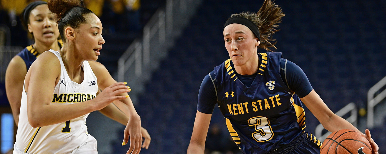 Kent State guard Larissa Lurken dribbles past a Michigan player.