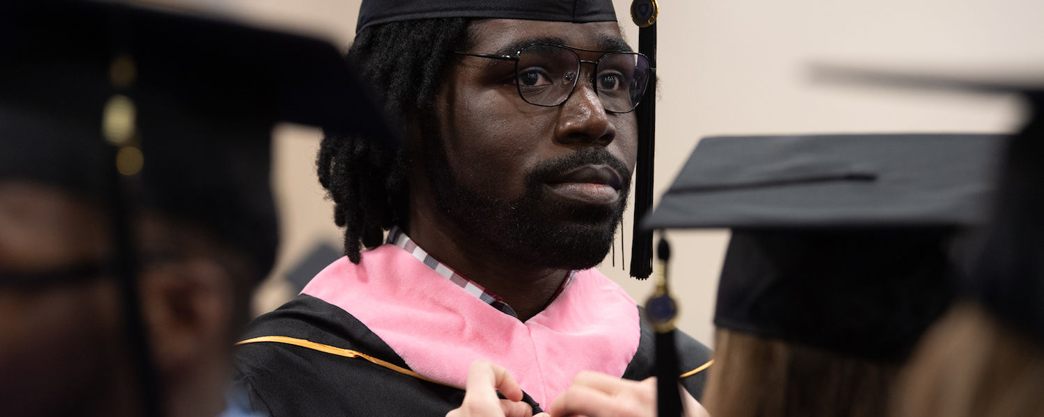 Dashawn Russel (MM '19) at Graduation