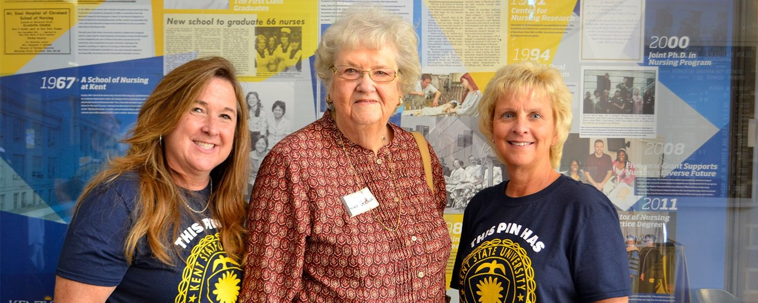 Dr. Davina Gosnell (center) poses with faculty member Mary Kutchin (left) and undergraduate program dean Tracey Motter (right) following the Homecoming 2017 festivities in Henderson Hall