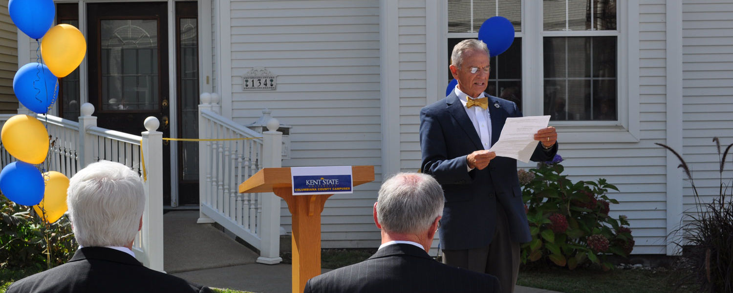 Dean Steve Nameth reads the official proclamation from the Kent State University Board of Trustees accepting the building as a gift from James and Keith Locke and officially naming it The Locke House.