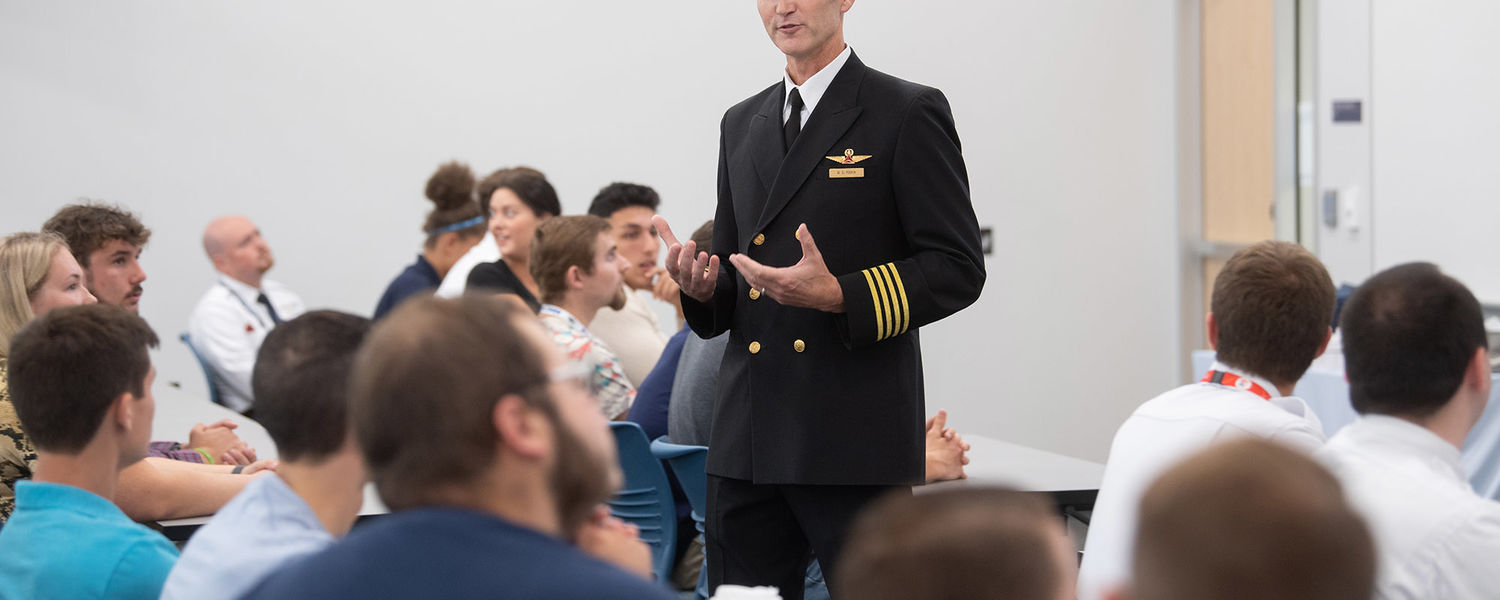 Delta Air Lines Capt. Mike Perrin talks to Kent State aeronautics students before the Delta Propel announcement.