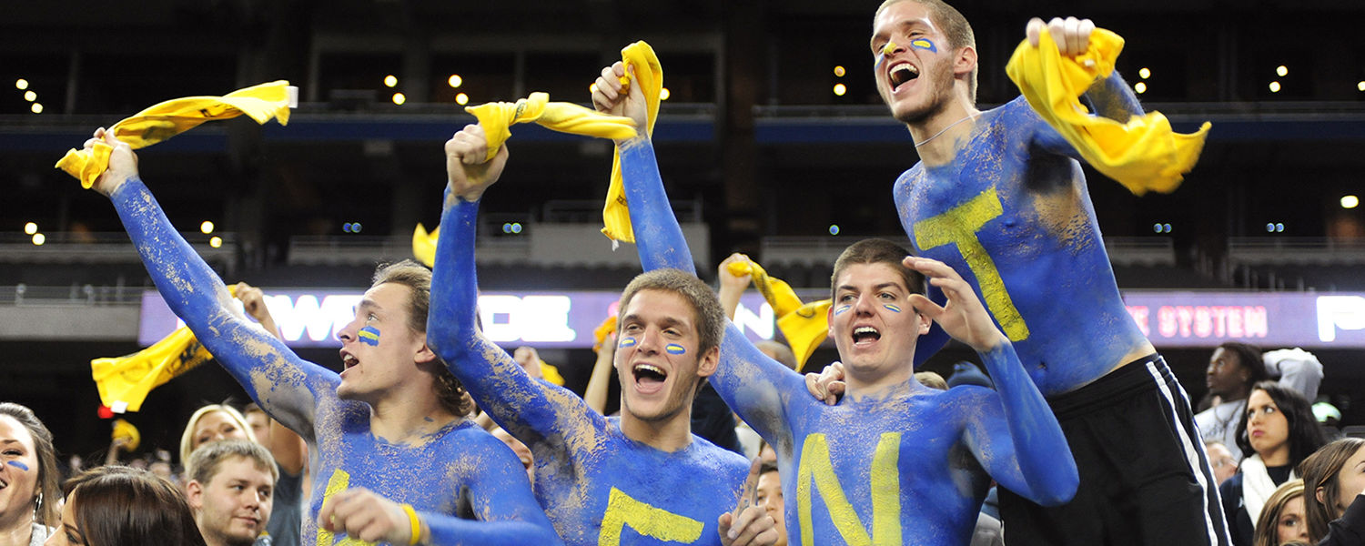 Kent State students cheer on the Golden Flashes during the MAC Championship game at Ford Field, in Detroit.