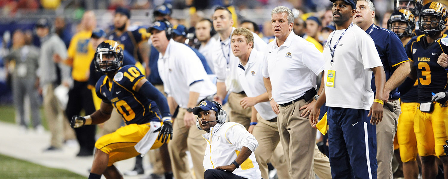 Head Coach Darrell Hazell and the team watch a field goal attempt in overtime, during the MAC Championship game at Ford Field, in Detroit.