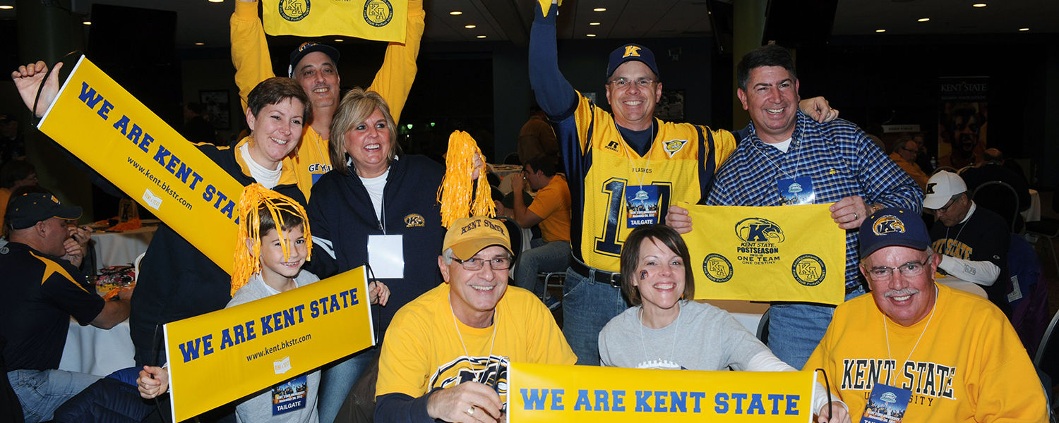 Kent State fans celebrate at an alumni pre-game dinner at Ford Field, in Detroit, prior to the start of the MAC Championship game.