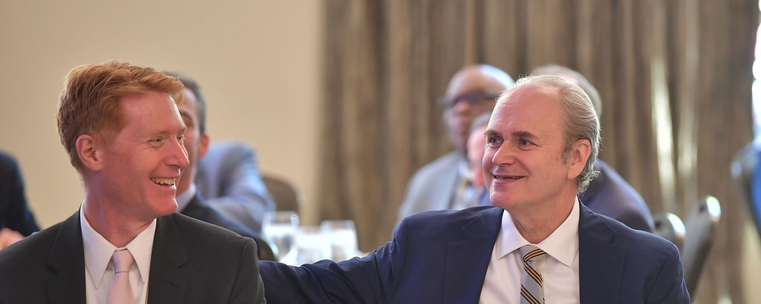 Kent State President Todd Diacon (right) shares a laugh with Kent City Manager Dave Ruller (left) during a breakfast with community leaders at the Kent State University Hotel and Conference Center.