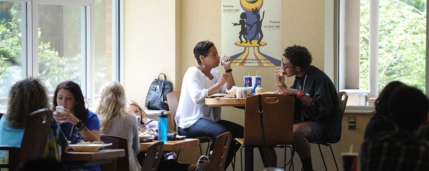 A Kent State student and parent eat lunch in the Eastway Center during Destination Kent State.