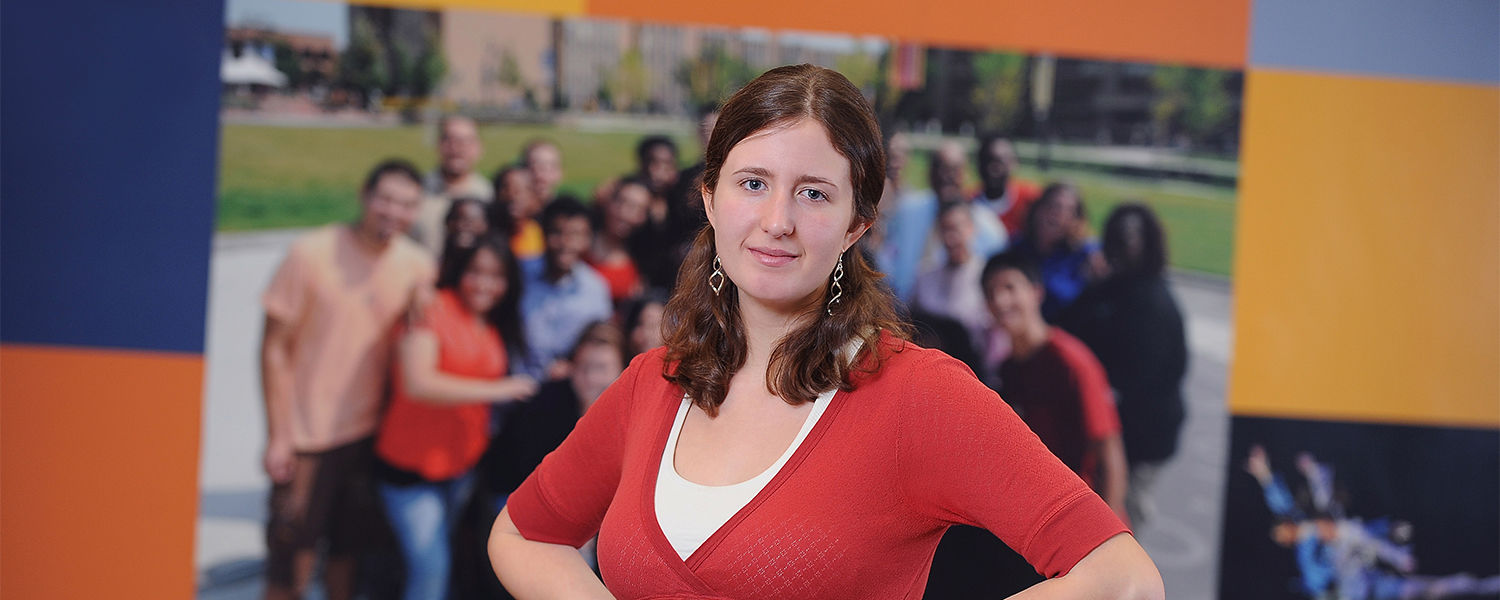 """Kent State sophomore Liz Schmidt poses in the Student Multicultural Center after taking top honors with her """"Compassionate Communities"""" essay."""