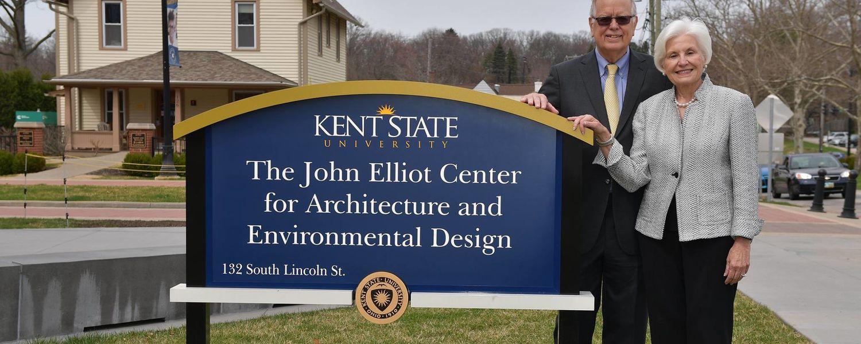 John and Fonda Elliot posing in front of sign