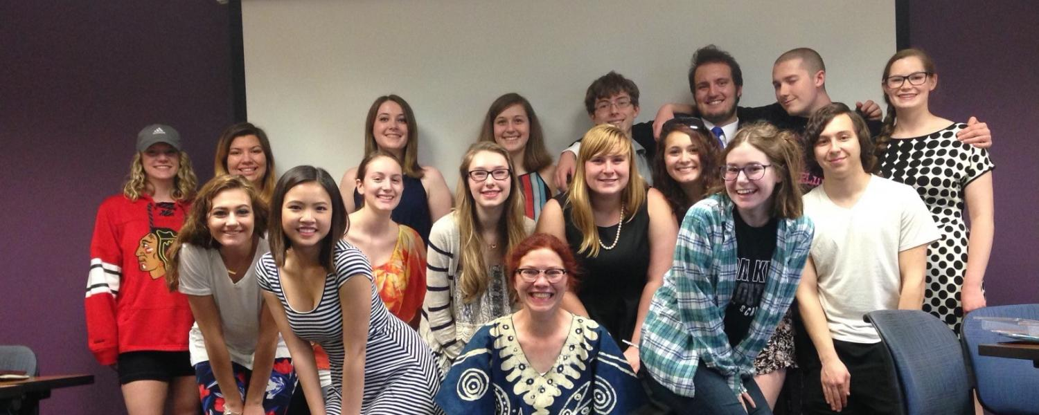 Dr. Elizabeth Howard standing with one of her Freshman Honors Colloquium classes.