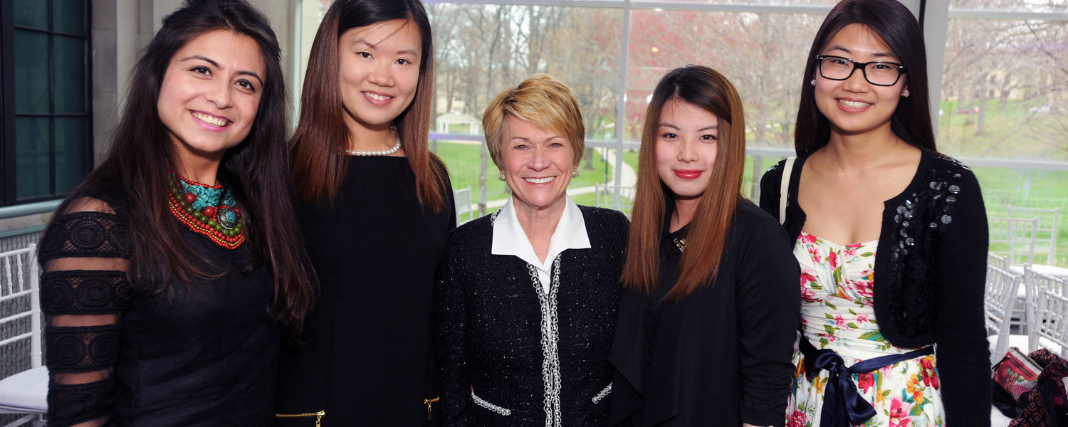 Kent State graduate students pose with Kent State President Beverly Warren (center) before the Annual Fashion Show.