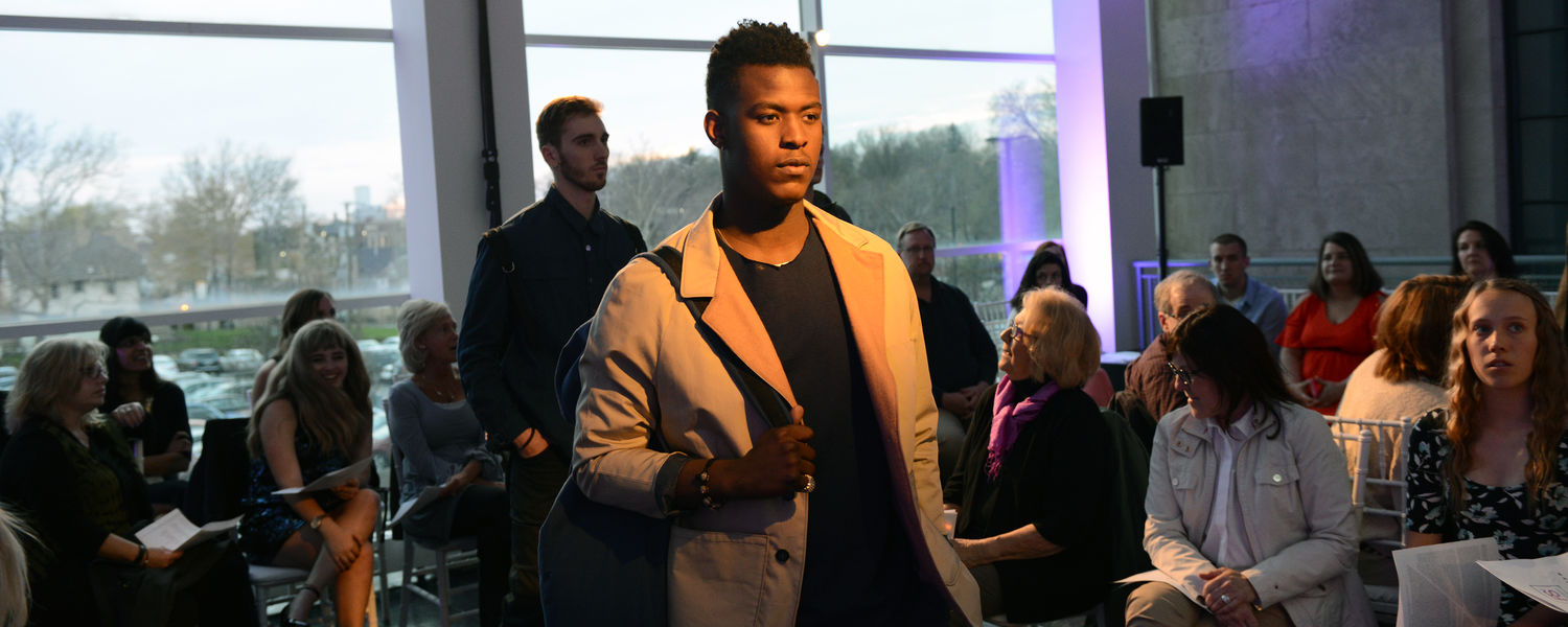 Models display a menswear collection created by a Kent State fashion design student during the Annual Fashion Show.