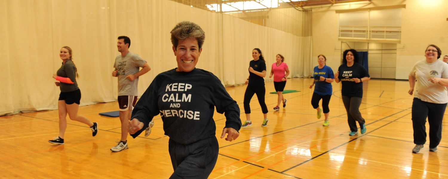 Ellen Glickman, professor and coordinator of exercise physiology and exercise science, leads faculty, staff and students in a running exercise during the Fit for Life afternoon program.