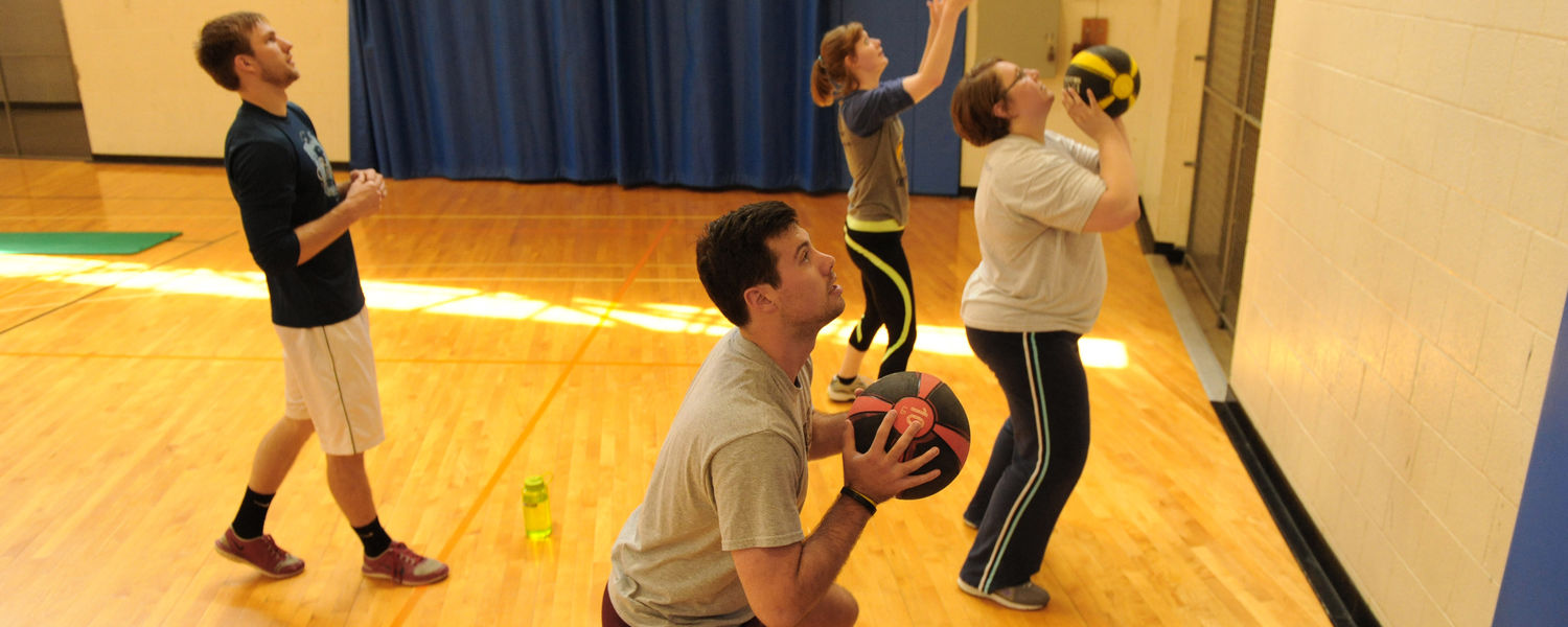 An exercise science major (left) helps lead a Fit for Life class at the MAC Center Annex.