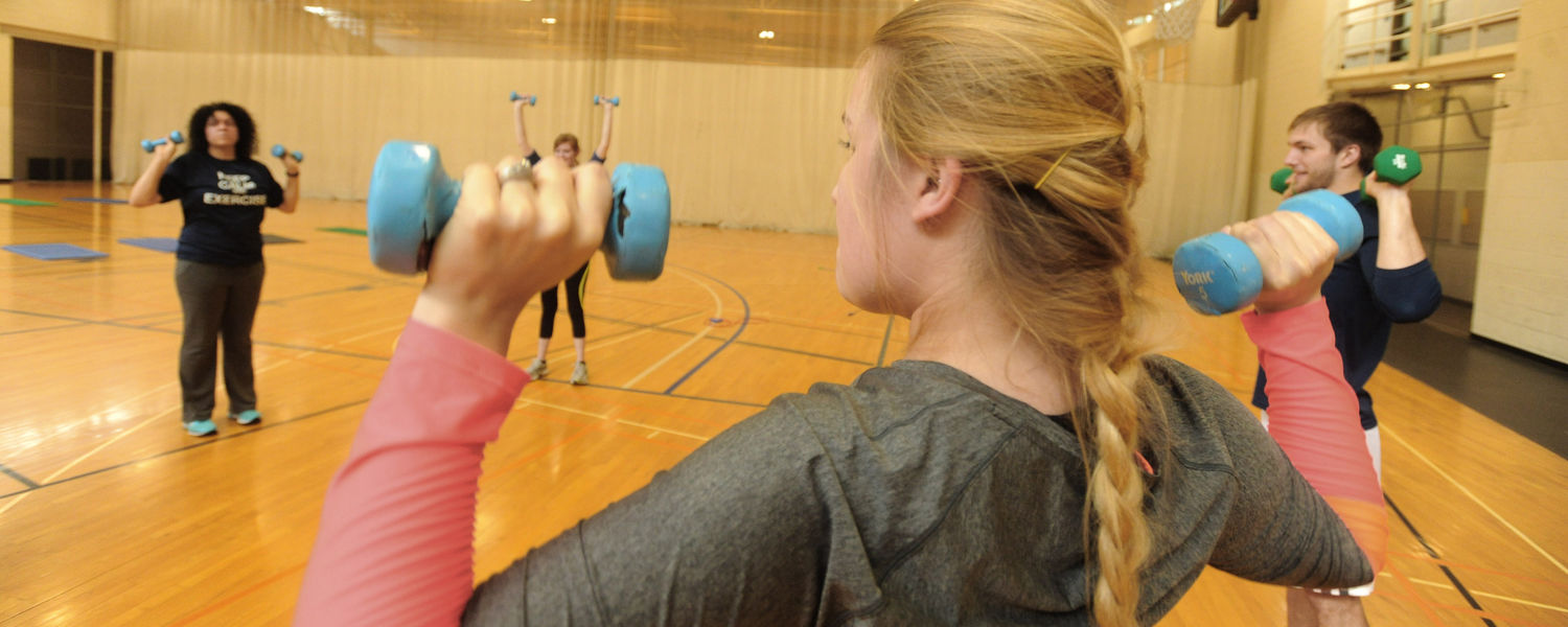 A senior exercise science student leads a Fit for Life class.