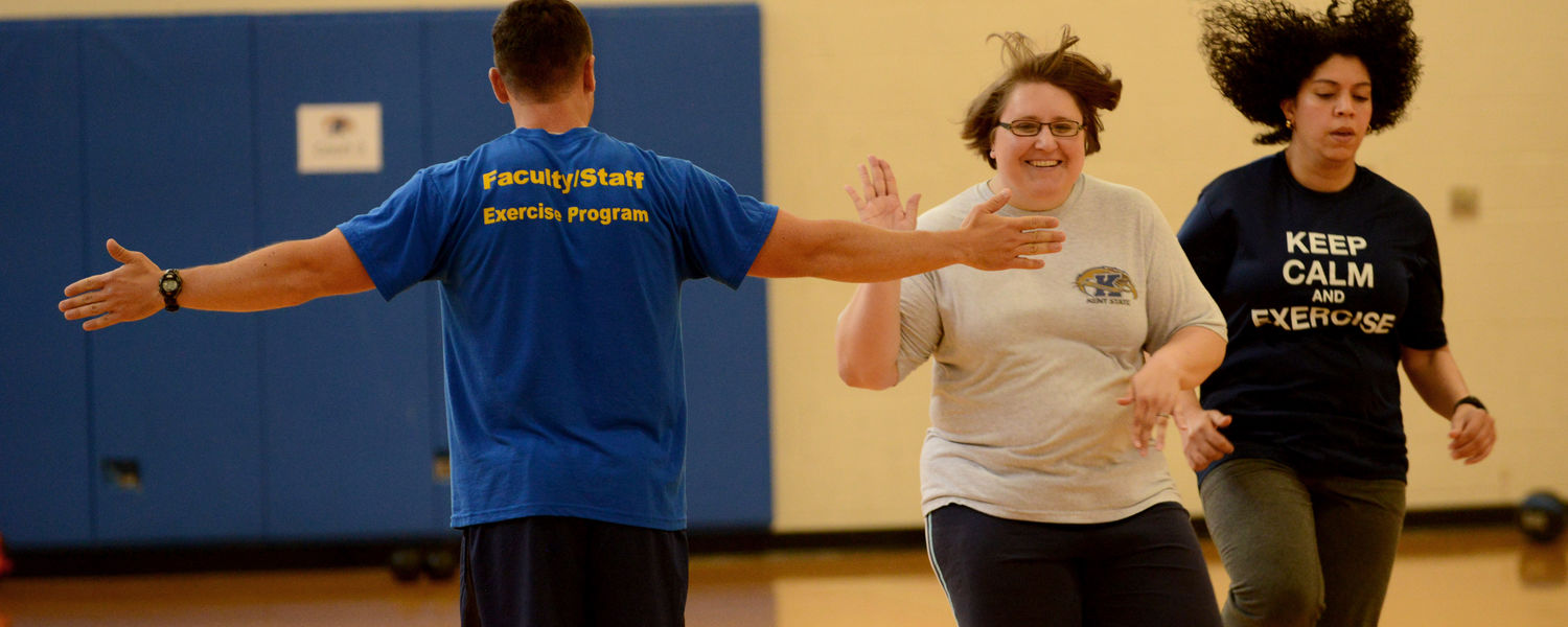 One of the participants in the noon Fit for Life class gives a high-five to a student instructor.