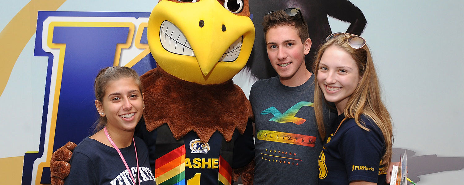 Kent State students pose for a picture with Flash, the university's mascot, following a meeting in The Nest. PRIDE! Kent is one of the 402 student organizations at Kent State.