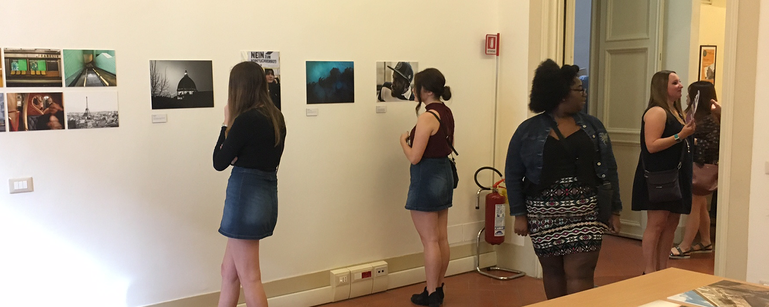 Other students in Florence inspect the students' projects during a special exhibition following the competition