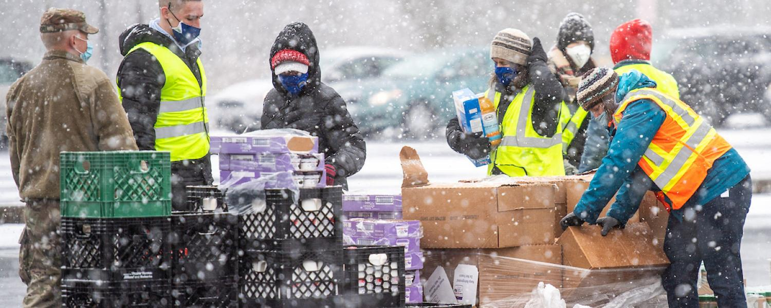 Volunteers from Kent State, the Akron-Canton Regional Foodbank and the National Guard assisted more than 200 families during the drive-through food distribution event on Wednesday at Dix Stadium.