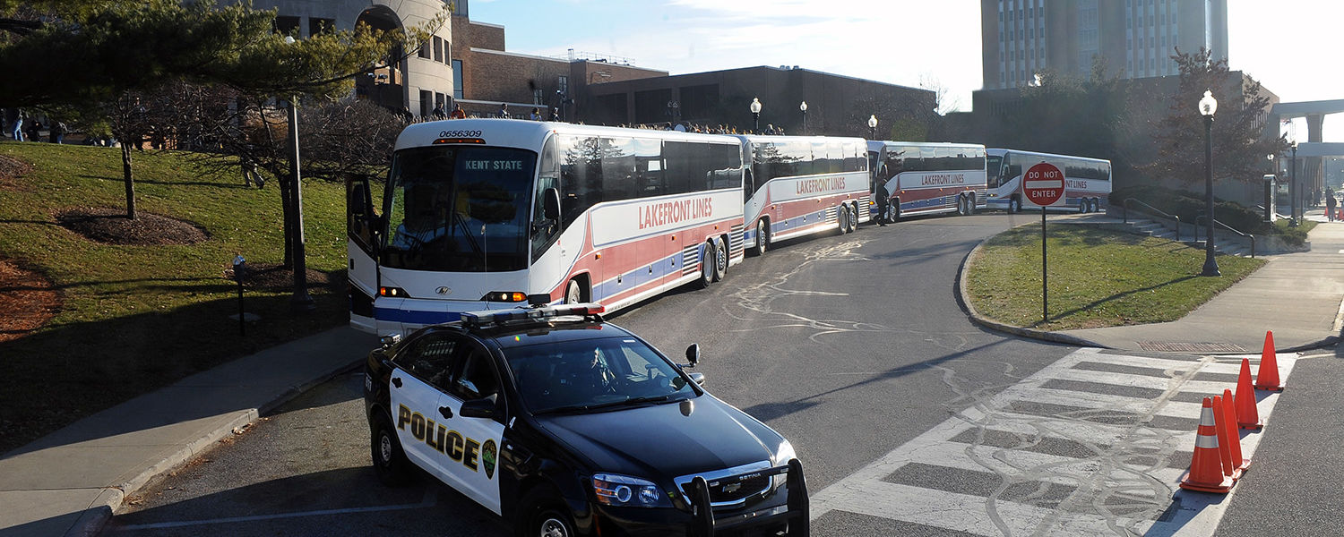The Kent State football team prepares to leave for the Mid-American Conference championship game in Detroit with a police escort to Kent's city limits.