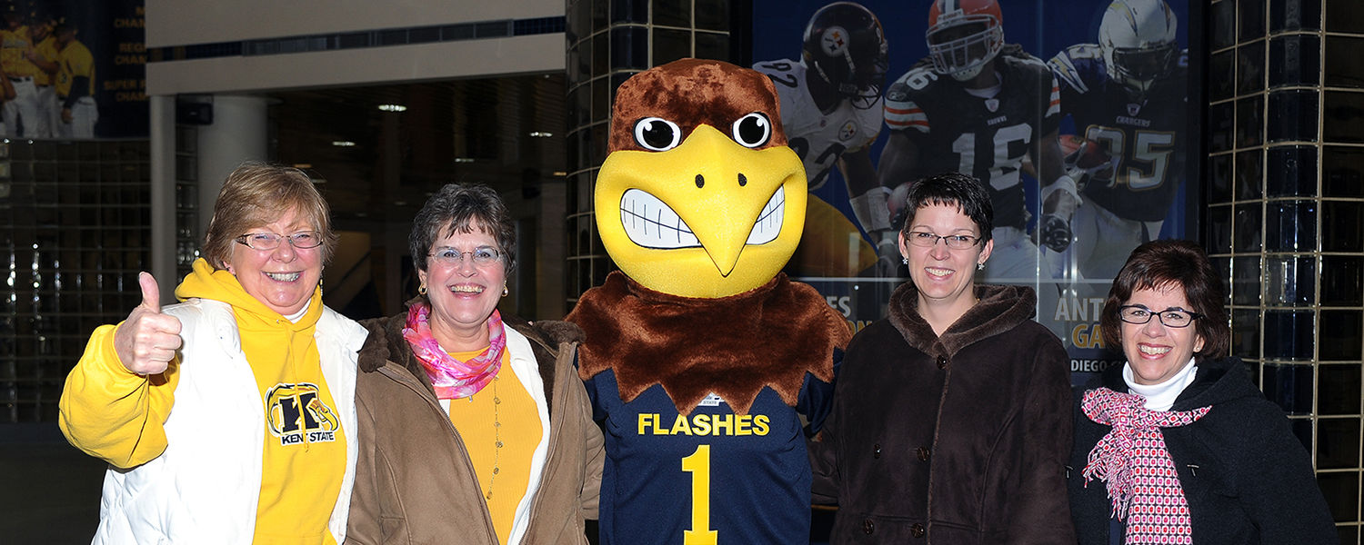Kent State employees show their team spirit with Flash, the university's mascot, as they enter the MAC Center for a send-off event as the football team heads to the Mid-American Conference championship game in Detroit.