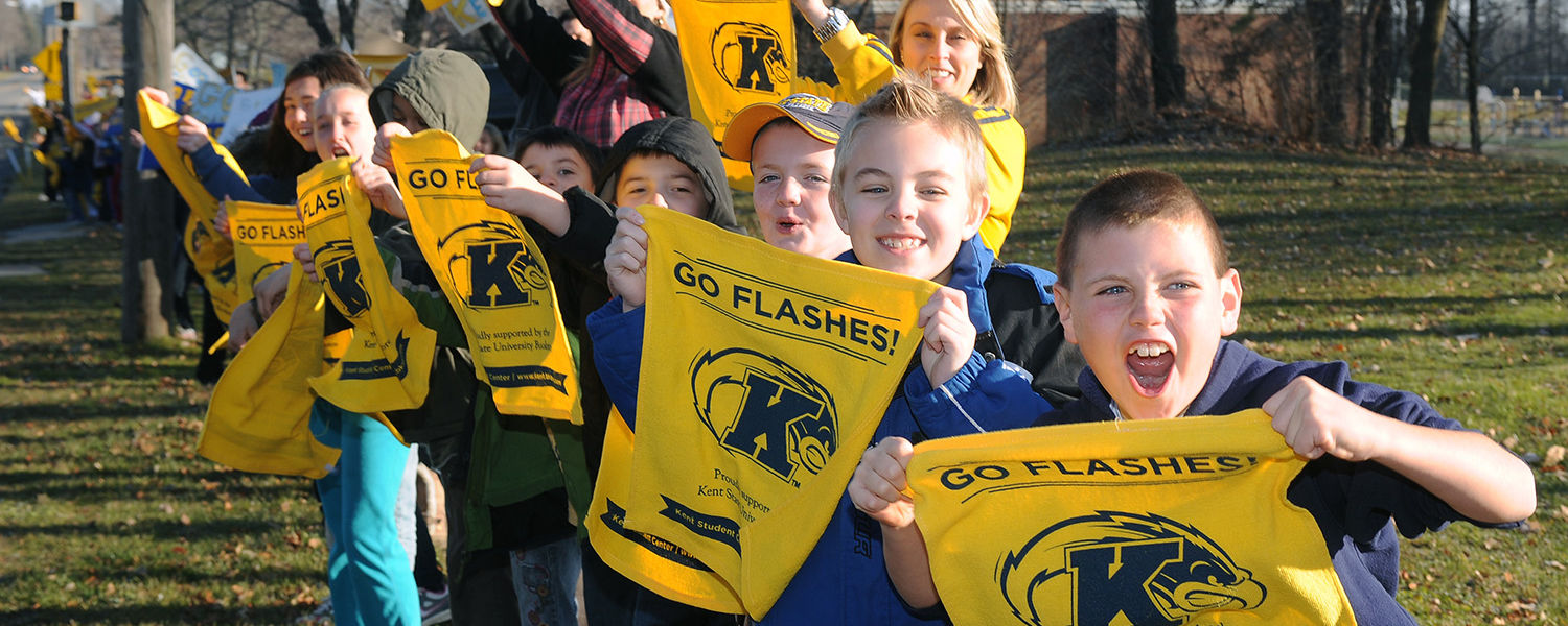 Students from Franklin Elementary School in Kent line Route 43 in a show of support for the Kent State football team as the team's buses head to Detroit for Friday night's Mid-American Conference championship game.