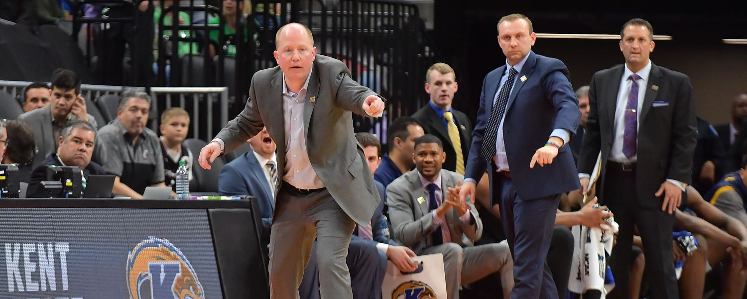 Kent State men's basketball head coach Rob Senderoff gives instructions to his players.